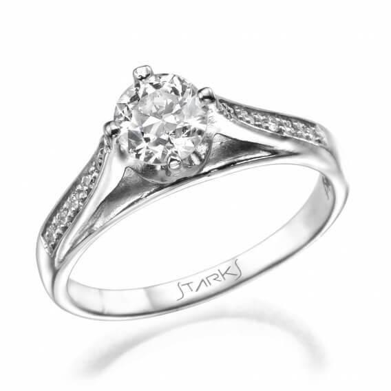 טבעת אירוסין מיוחדת בשיבוץ יהלומים וזהב צהוב