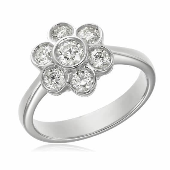 טבעת יהלומים עדינה זהב לבן בעיצוב פרח
